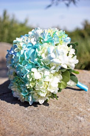 Bouquets for bridesmaid. More of a circular ball and slightly larger.