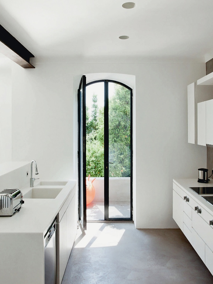 steel windows, concrete floors, white kitchen