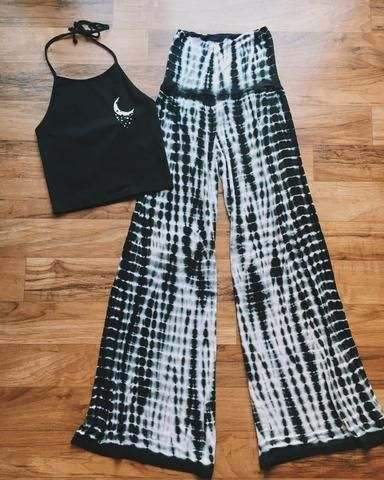 Show off your hippie spirit with these Tie Dye Palazzo Pants! These pants feature a black and white tie dye design, a relaxed fit and a stretch waist. We love them paired with a t-shirt or crop top! 9
