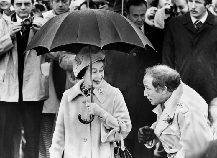 In one of the iconic photos from the Star's photo archives donated to the Toronto Public Library, former prime minister Pierre Trudeau appears reluctant to share Queen Elizabeth's umbrella during a 1977