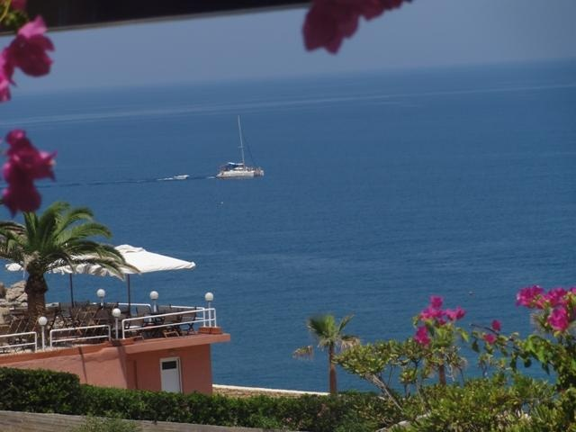 WATCHING THE SAILING BOATS GO BY FROM OUR TERRACE