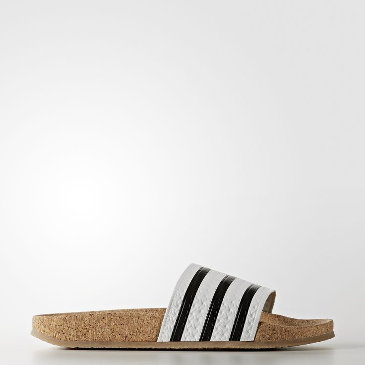 "In the early '70s, adidas created ""shower shoes"" for Germany's national football team to wear in communal locker rooms. The resulting slide, known as the adilette, became an international best-seller, worn by college students and celebrities alike. These women's sandals update the original with a natural, sustainable and ultra-comfy cork-wrapped midsole. A textured leather bandage flashes embossed 3-Stripes and the slightly see-through rubber outsole adds to the distinct..."
