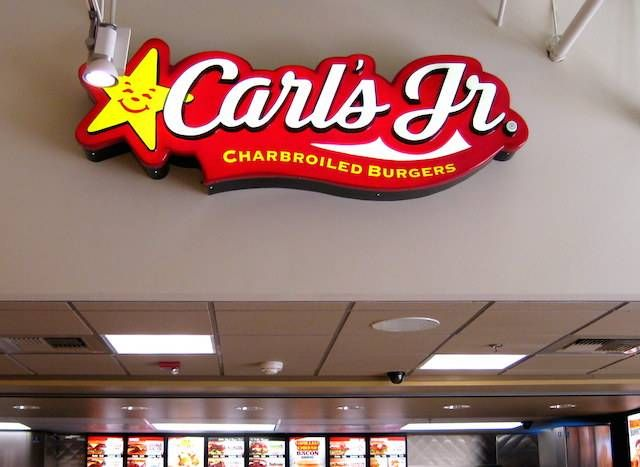 Carl's Jr.     Carl Karcher was born January 16, 1917 in Upper Sandusky, Ohio. He dropped out of school when he was 13 and worked on his family farm for the next seven years. When he was 20, he got a job making $18 a week working for his uncle at a feed store in Southern California. In 1941, Karcher was working in a bread factory and managed to get a $311 loan against his new Plymouth sedan. Using the loan and $15 out of his wallet, Karcher bought a hot dog stand and served them outside the…