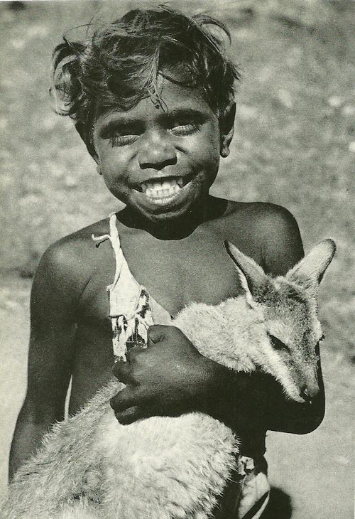 Aboriginal boy with kangaroo pet, Australia National Geographic | October 1955