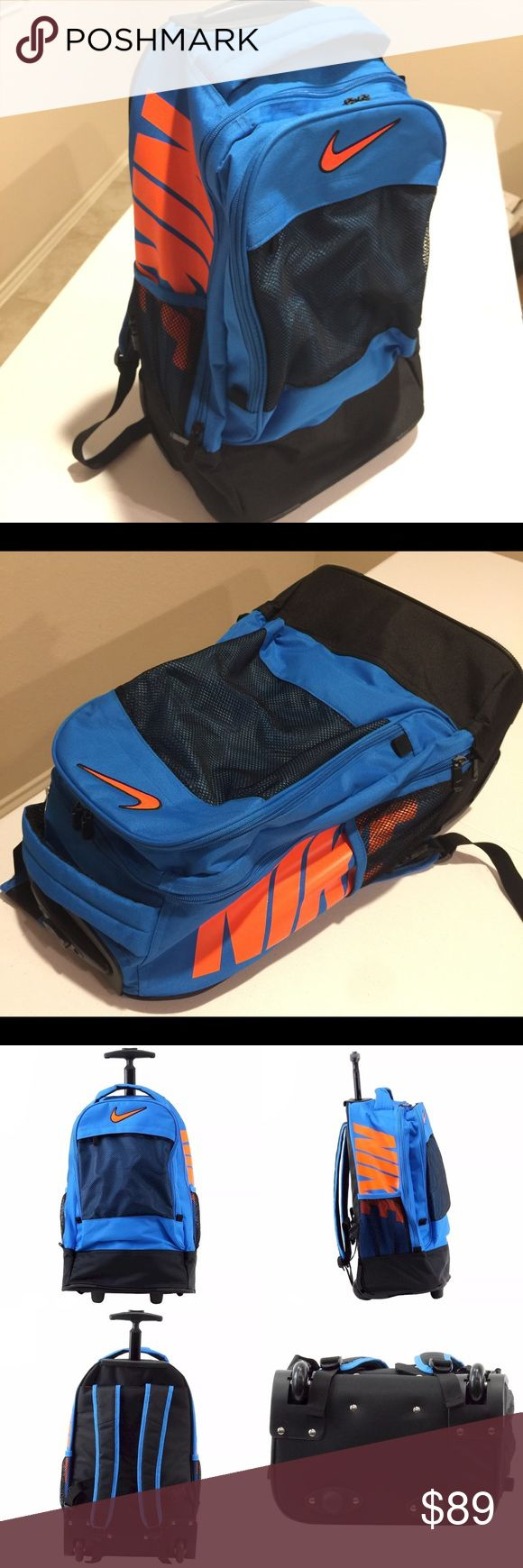 NEW! NIKE FULL SIZE ROLLER NEON ORANGE BLUE BAG Brand new with tag!  Nike neon orange and blue colored backpack, bag, suitcase, etc.  Handle extends up for easy strolling with this awesome bag on wheels!  Bold colors and huge, bold NIKE prints on both sides of the bag and embroidered NIKE emblem in bright orange at the front of the bag!  PERFECT FOR TRAVELING AND BACK TO SCHOOL!!!  Full size ADULT BAG! Nike Bags Backpacks