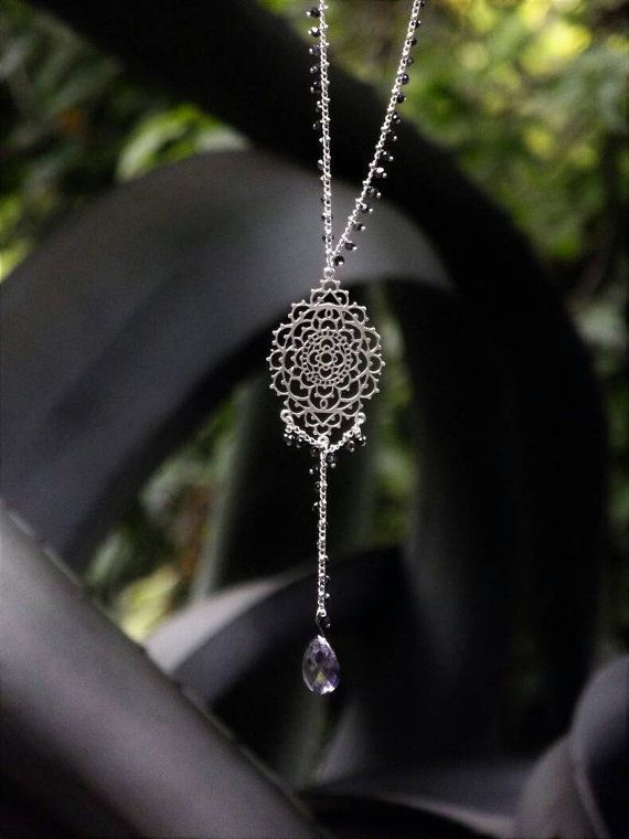 A rosarium necklace with a filigree pendant by AlphaPiDesigns