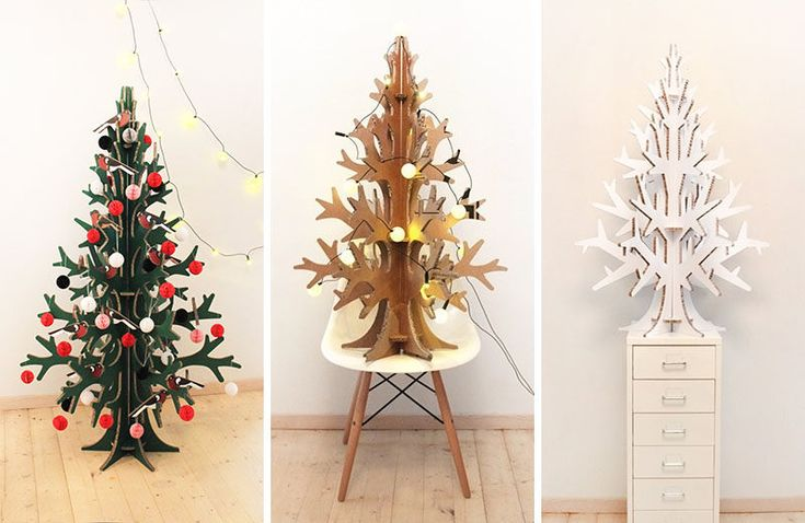 12 Modern Christmas Trees You Can Decorate With This Holiday Season Laser-cut recycled cardboard christmas tree from Cardboard Christmas
