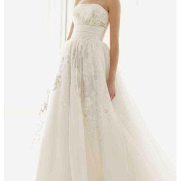 """Melissa sweet wedding gown Ivory. Beautiful silver and antique embroidery detail throughout dress. You can find this dress on davidsbridal.com. I bought for $950 but it has since gone down in price to $650. Originally $1300. I am selling it for $450. Worn for bridals and wedding day. Needs to be cleaned. Never altered. Size 12. I am normally a size 8 jeans, medium top, 34 DD, 5'5"""". It is long.. Dresses"""