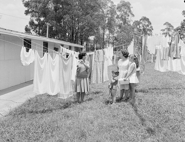 Spanish migrants hang out the washing and chat at Villawood, 1963.