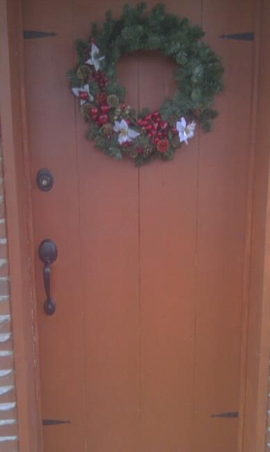 homemade door after stain and salvaged iron hinges cut and added