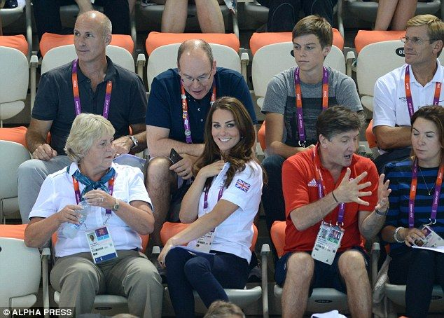 Royal small talk: The pair continue to chat while they wait for the swimmers