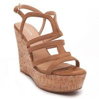 High heel cork platforms in camel colour with suede texture and laser- cut straps.