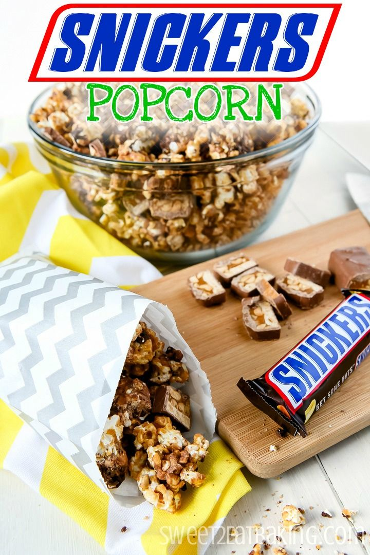 Snickers Popcorn by Sweet2EatBaking.com - Popcorn smothered in caramel, topped with salted peanuts, chopped Snickers, then drizzled with dark chocolate.