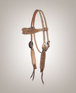 Making this headstall unique, the driftwood print is on the premium leather of this headstall in the Copper Bullets Collection from Cactus Saddlery. Copper bullets cover the browband, buckle sets and cheek pieces of this headstall.  Copper concho bit-end Copper rivets-no chicago screws