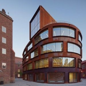 Tham+&+Videgård's+Stockholm+architecture+school+features+a+curving+skin+of+pre-rusted+steel