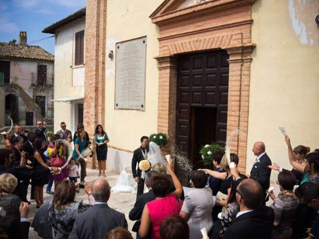 A sweetest couple at the exit of the church during their wedding in Italy