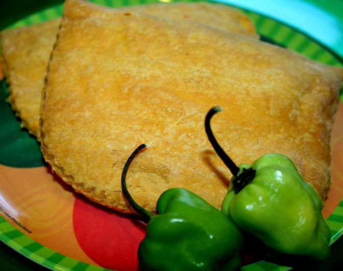 A traditional Jamaican favorite with a ground beef filling that features hot peppers cooked in a flaky pastry shell. The Jamaican patty can be eaten as a full meal or snack. It is often pair with coco bread as a part of a full meal. Here is our Jamaican beef patty recipe.