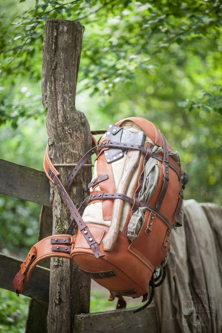 """Full-functional large hiking backpack of oiled leather and weathered canvas. Soft straps, detachable belt. One side entrance and one large  internal pocket, one external pocket and a """"beaver tail"""" system."""