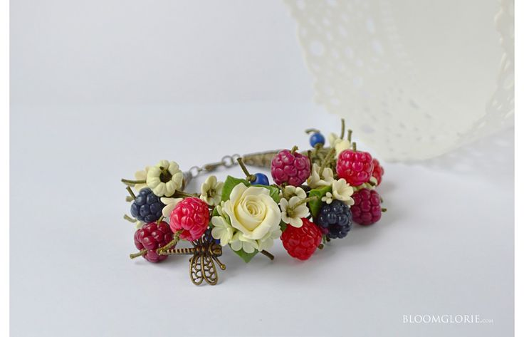 Stylish bracelet with berries, flowers, turquoise and  bronze findings. #berries #petals #fotoset #set #jewelry #luxury #cristmas #bracelet #mix #juicy #jewelry #exclusive #cherry #orange #strawberry #polymerclay