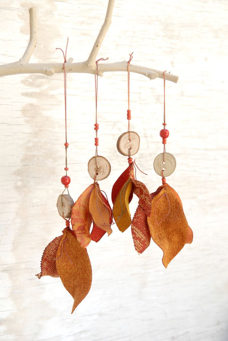 Beautiful handcrafted fabric leaves ornament in rich fall colors, with red wooden beads and a wooden handmade button, with a hand dyed cotton thread. Great housewarming gift.  You will receive ONE ornament {each is slightly different}.  Ready to ship. ****************** http://www.etsy.com/shop/mywhiteflower  http://www.flickr.com/photos/osnatganor/  https://www.facebook.com/odpaamosnat   Thanks for visiting my shop