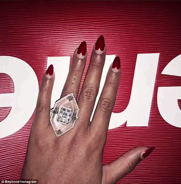 A push present? The Austin Powers actress also flashes this big ring and displayed a cute ...
