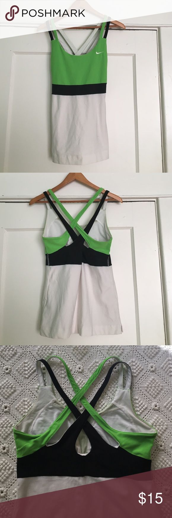 Nike top such an amazing workout top. built-in bra. beautiful crossed straps. dri-fit material. Nike Tops Tank Tops