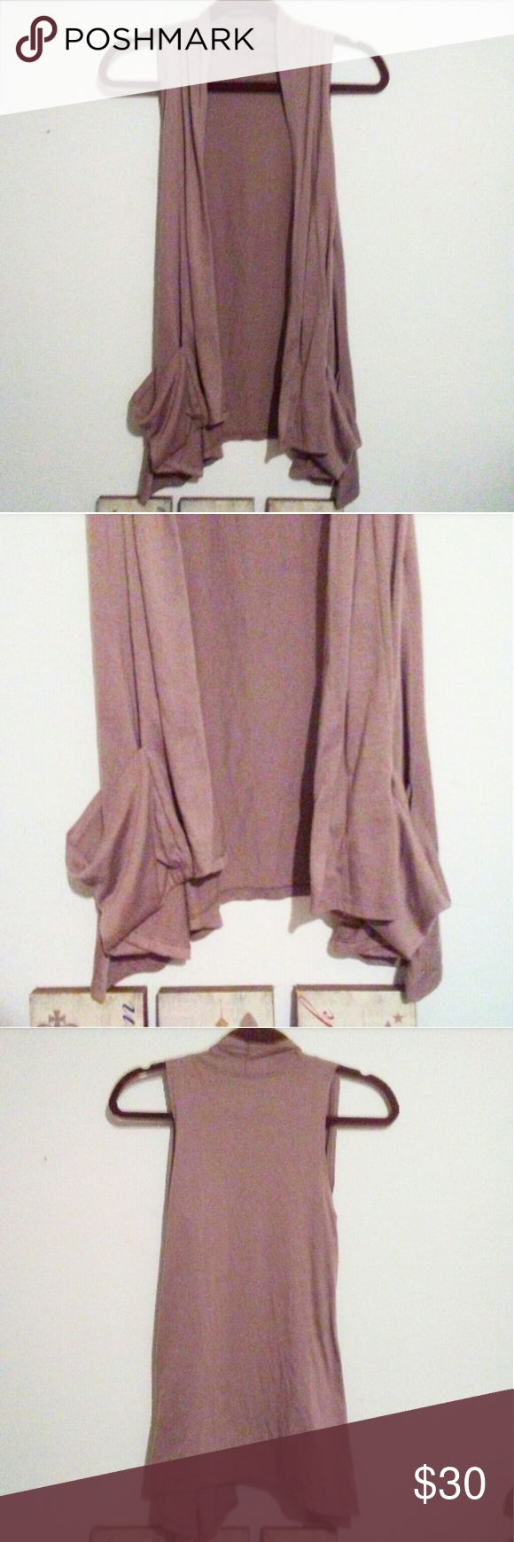 Celebrity Pink Vest Cute soft tan colored long vest with pockets. Great condition  Really cutebwith anything! Celebrity Pink Tops