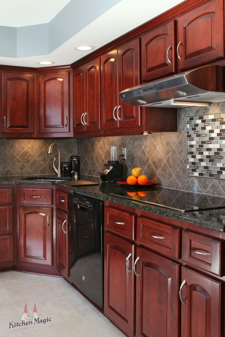 This Kitchen Does An Excellent Job Of Contrasting Cool And Warm Colors Into A Coh Red Kitchen Cabinets Cherry Wood Kitchen Cabinets Granite Countertops Kitchen