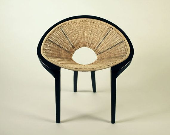 This is a sturdy, solid, handcrafted oak wood seat that strictly follows an established aesthetic set of proportions, and is clearly grateful to a typically Scandinavian 1950s modernist perspective.    The tequila plant (agave) inspired the open cone shape design and, to convey that warm farmhouse feel, woven wicker is the material of choice to bring together the seat's wooden elements.This may be purchased on ecofirstart.com