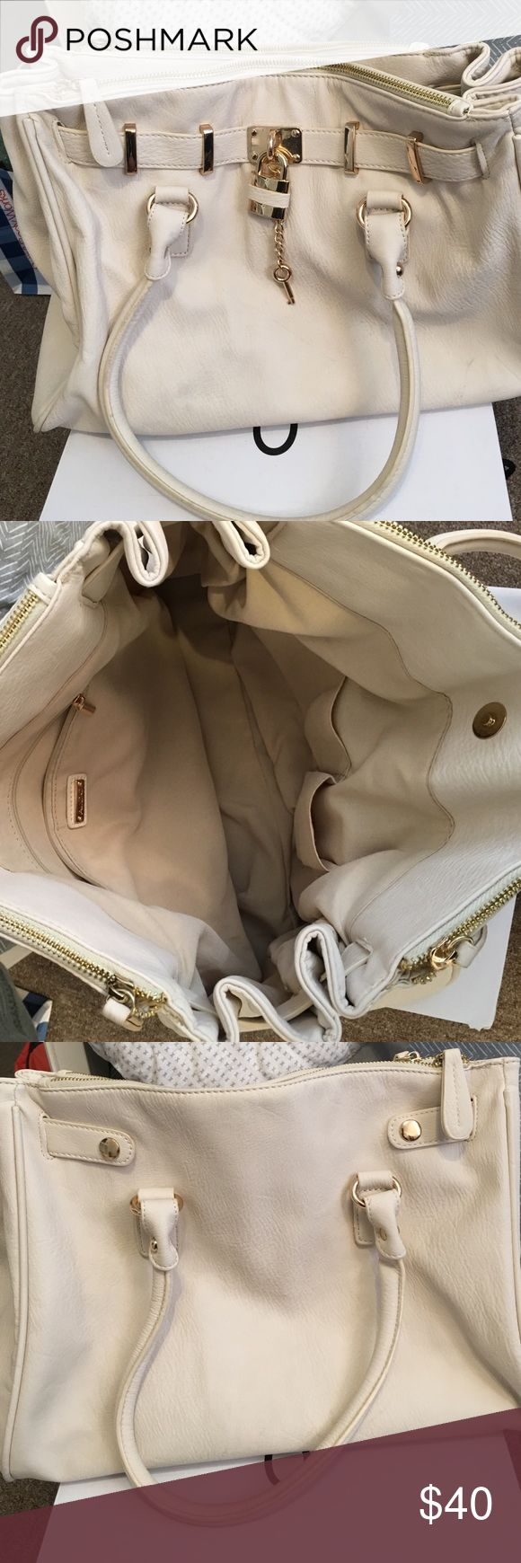 Aldo tote bag! In off white. Super cute. I got this bag and have only used it once! It's still in good condition. Super cute and roomy for your necessities! I have no use for it, and I rather sell it to someone who will. Aldo Bags Totes