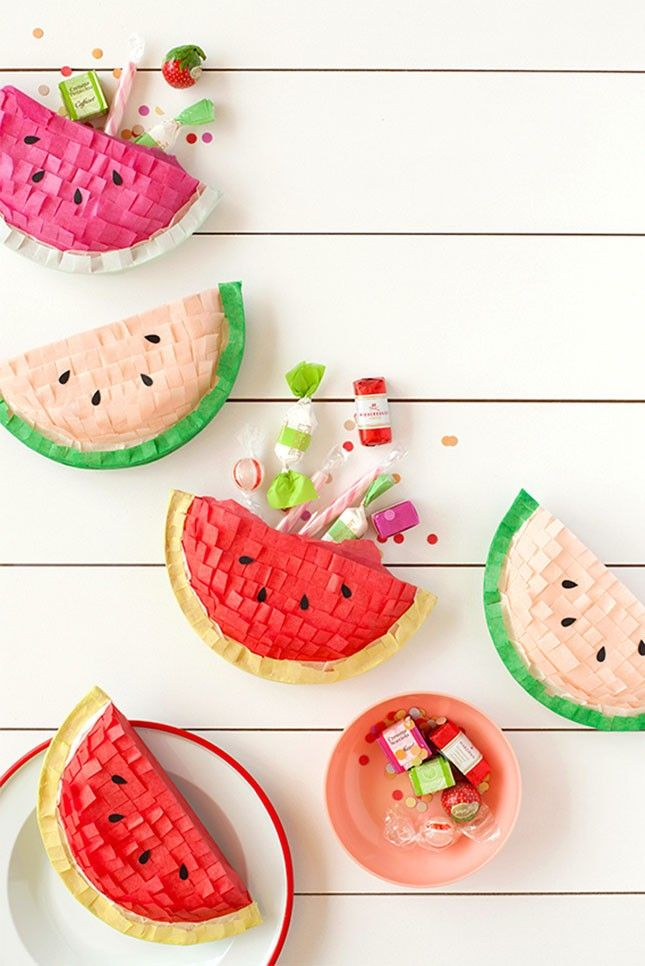 if you are throwing a summer pool party a set of diy watermelon piñatas is a must...