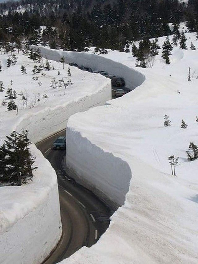 "These walls of snow are 20 meters high. Corridor ""cut through"" in the thick snow, and its axis coincides with the axis of the road. This is happening every year in April, in Japan's Tateyama Kurobe mountain route."