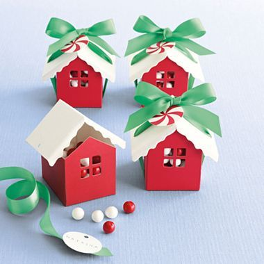 Charming and clever house-shaped favor boxes add a creative touch to party treats. Fill them full of yummy candy, nuts, crackers, etc.. and place at each table setting or simply give to each guest when they leave.