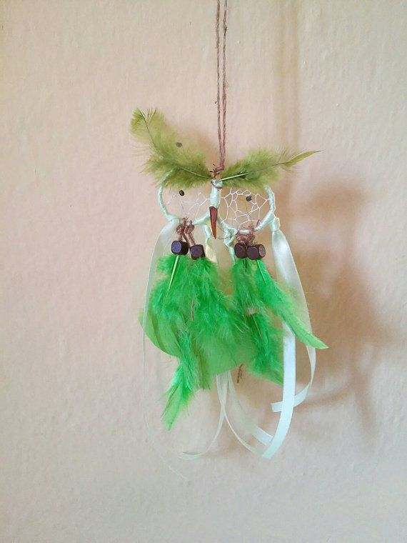 Check out this item in my Etsy shop https://www.etsy.com/listing/473525393/green-owl-dream-catcher-wall-decor-green