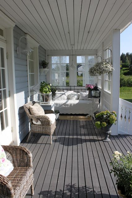 Outside porch daybed rest area whitewashed cottage chippy Cottage porch decorating ideas