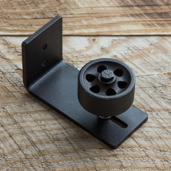 The Stay Roller Guide comes with an adjustable wheel and in a black powder coat finish. It is optimal for larger doors and doors on exterior applications, and can also be used to attain a certain aesthetic style by adding bulk to the bottom of the door along with the barn door hardware along the top.