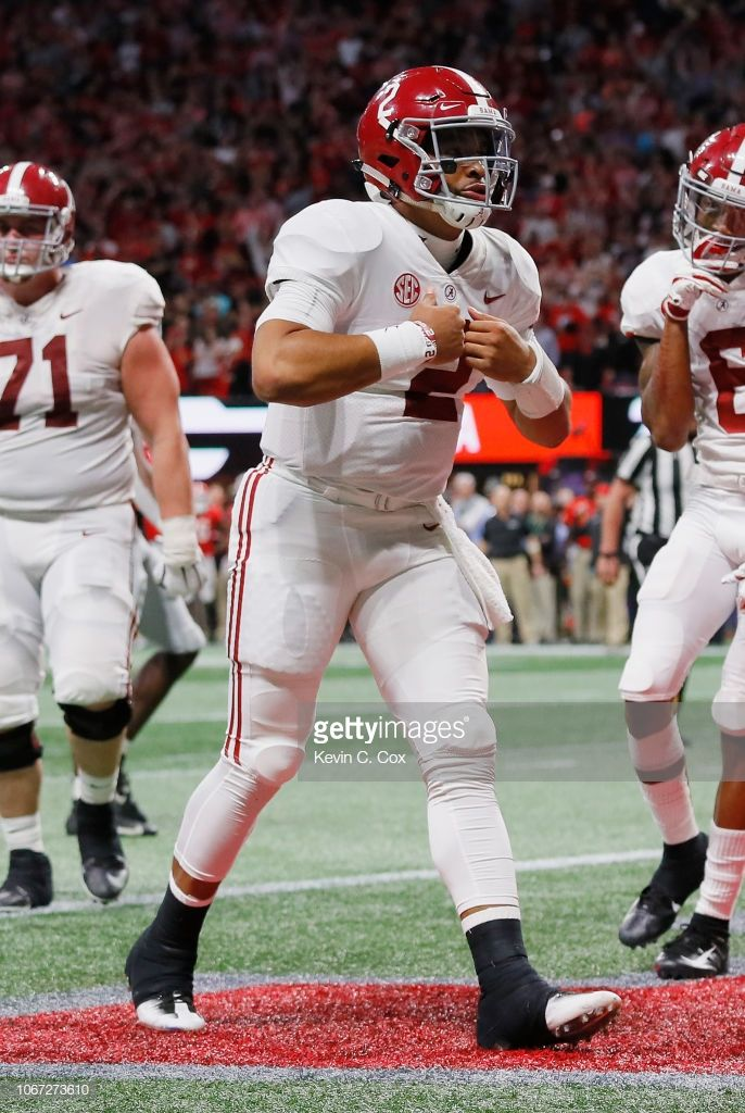 Jalen Hurts of the Alabama Crimson Tide celebrates after rushing for ... 22d399f65