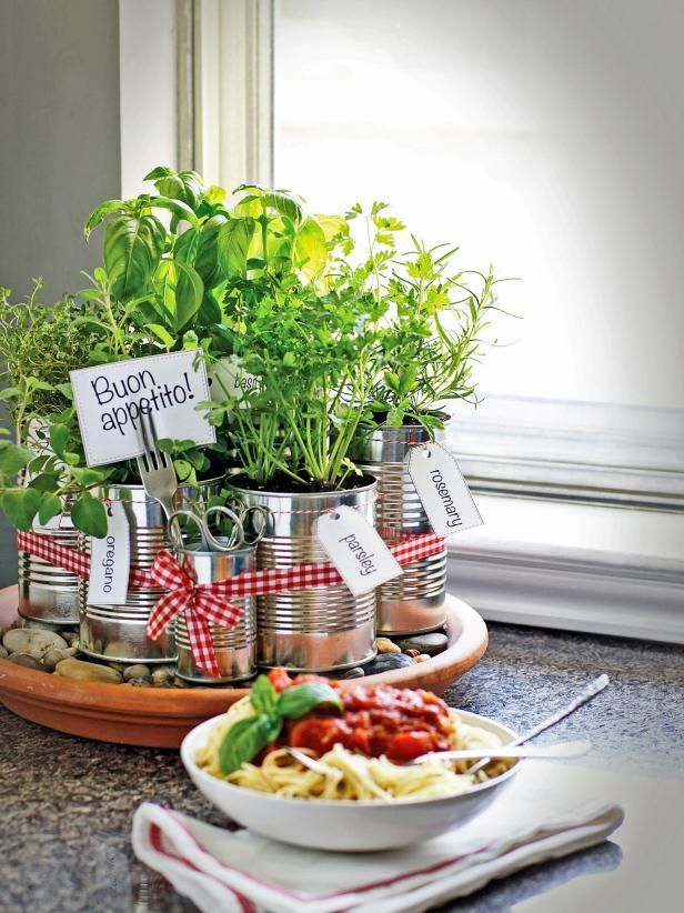 The kitchen decorating experts at HGTV.com share step-by-step instructions for upcycling empty tin cans into a handy kitchen countertop herb garden.