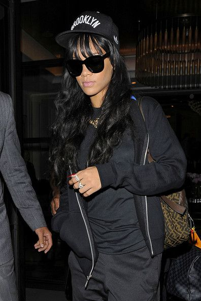 Rihanna Photos - Rihanna looks ready for a workout as she leaves her hotel and heads to a gym in London. The Barbadian singer, seen wearing a Brooklyn cap, headed to the Fitness First Gym in West London rocking hi top sneakers and her workout clothes. - Rihanna looks ready for a workout as she leaves her hotel and heads to a gym in London