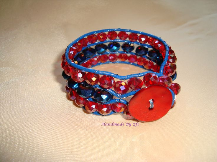 bracelet with glass beads in red and blue. bound in blue leather lanyard, button ivory  https://www.facebook.com/pages/Handmade-Creations-by-Efi/187659788043676