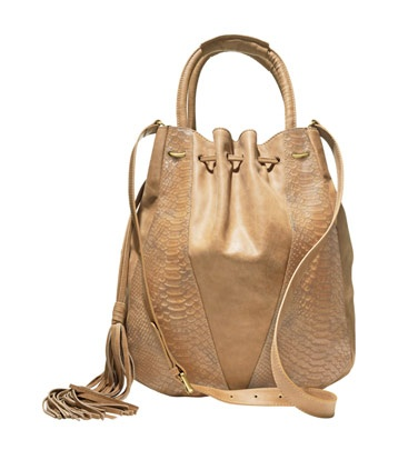 This gorgeous, hobo inspired bucket bag will be your staple bag for this season. The neutral light tan will pair with absolutely anything!
