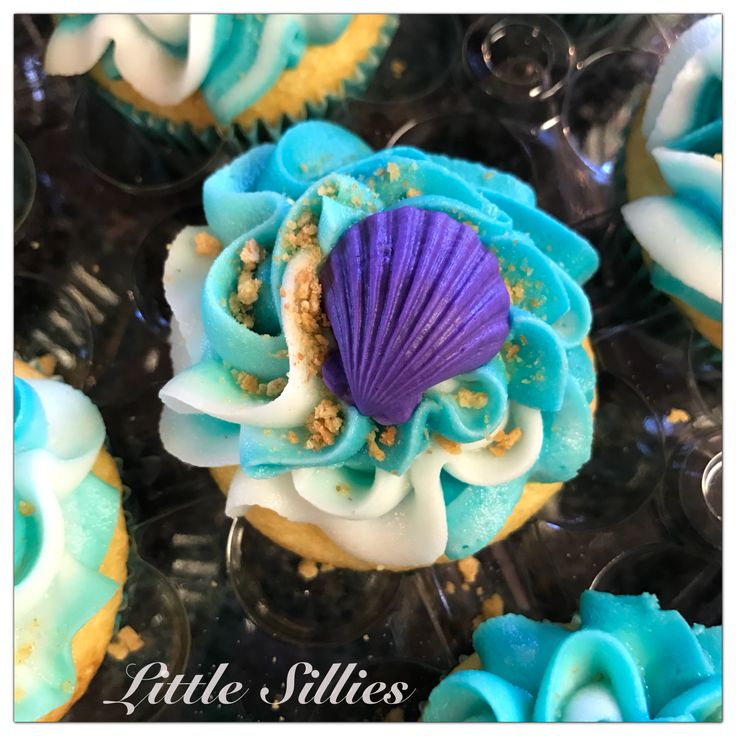 Water, sand and seashells cupcakes for a Finding Dory themed party.