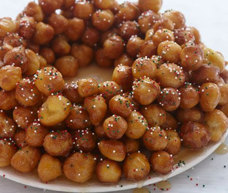Struffoli! A traditional Italian holiday creation of fried dough balls, held together with honey and into a wreath shape.