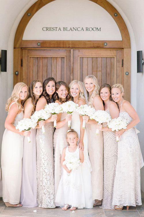 Mismatched neutral bridesmaid dresses with white bouquets | @clanegessel | Brides.com