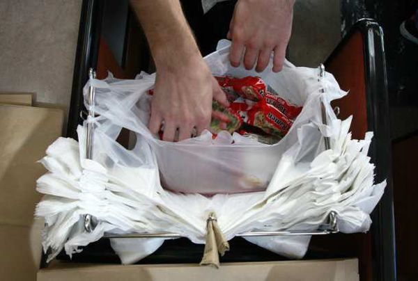 Los Angeles became the largest city in the nation to approve a ban on plastic bags at supermarket checkout lines.