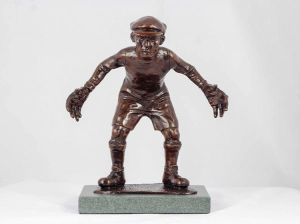 #Bronze #sculpture by #sculptor Graham Ibbeson titled: 'Bring it on Bronze Boy Playing Football Goalkeeper'. #GrahamIbbeson