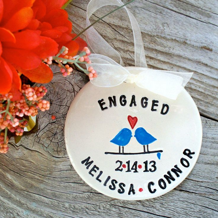 Personalized Engagement Ornament - Love Birds - Engagement Gift for Couple - Ceramic Ornament - Dated Ornament by SayYourPiece on Etsy https://www.etsy.com/listing/170928113/personalized-engagement-ornament-love