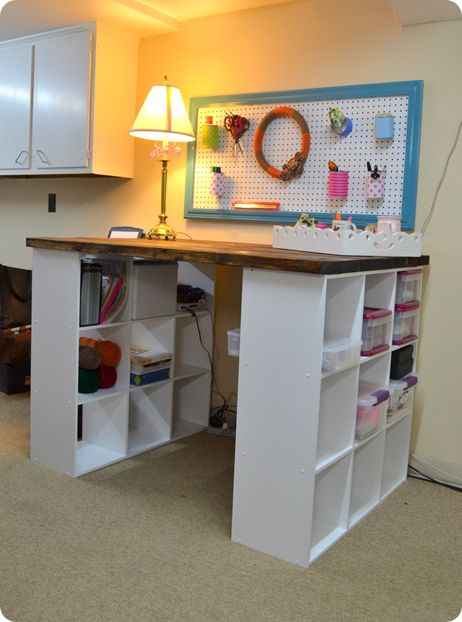 I need a crafting/art table. Bookshelves and a nice wooden top is the perfect solution!