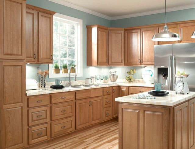Kitchen Remodel With Oak Cabinets And Gray Wall Paint Colors And Laminate  Flooring