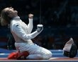 """""""Italy's Vezzali celebrates defeating Tunisia's Boubakri during their women's Individual Foil quarter-final fencing competition at the ExCel venue at the London 2012 Olympic Games"""" This is passion."""